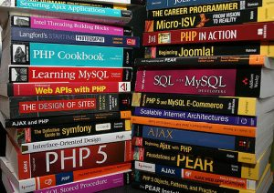 Cal's Stack of Books – CC BY Cal Evans